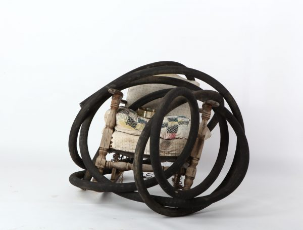 Lonnie Holley, WEIGHED DOWN BY THE HOSE, 2008 Found rocking chair, old quilt, heart-shaped box, rubber hose Image courtesy of the artist